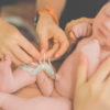Mother tying umbilical chord