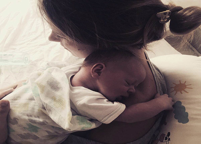 Birth Stories: Mother holding baby Blake